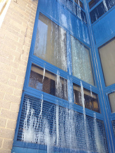 Water from broken sprinkler system streamed out upper windows at Bayard Middle School, then froze. (Photo: DFN)