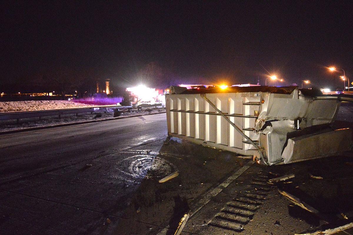 Dump truck hit 12th Street overpass on I-495, split
