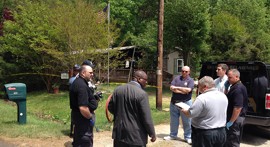 Investigators stand at scene of fatal fire on Reynolds Road near Frederica. (Photo: Delaware Free News)