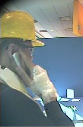 Police said robber had bandaged hand.