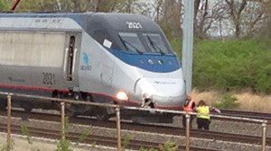 Amtrak Acela train, with damage to its right front, waits on the tracks after fatal accident Thursday afternoon near Claymont train station. (Photo: Delaware Free News)