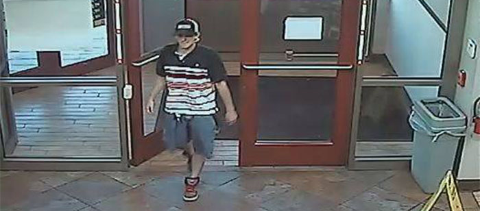 Surveillance image of suspect in wallet theft released by Delaware State Police.
