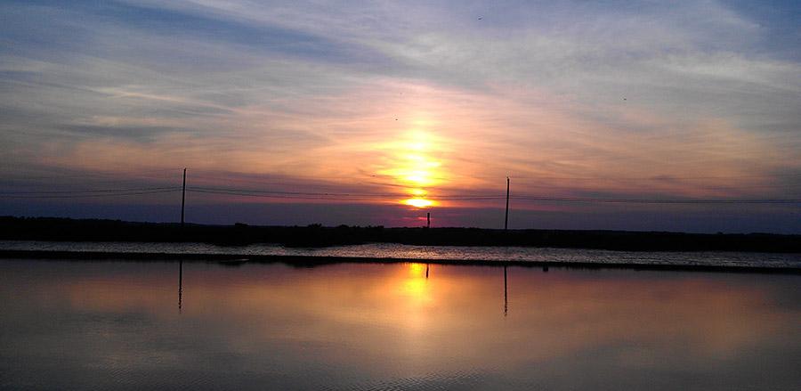 Sun sets today over Cedar Creek at Slaughter Beach. (Delaware Free News photo by Jon P. Zaimes)