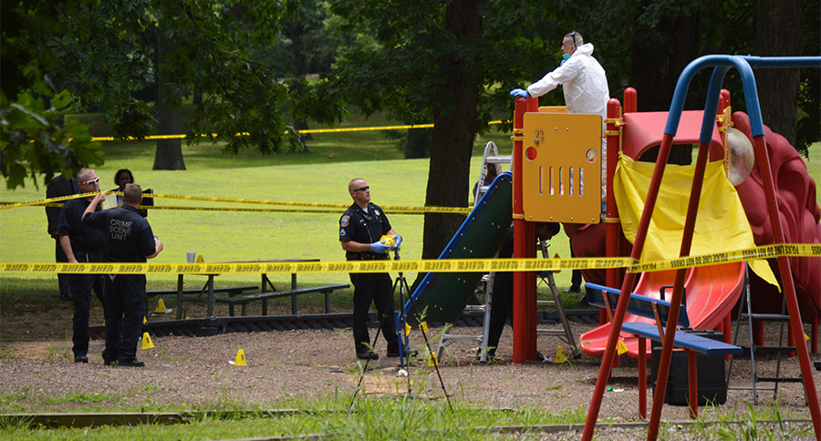 Investigators work at scene in Canby Park. (Photo: Delaware Free News)