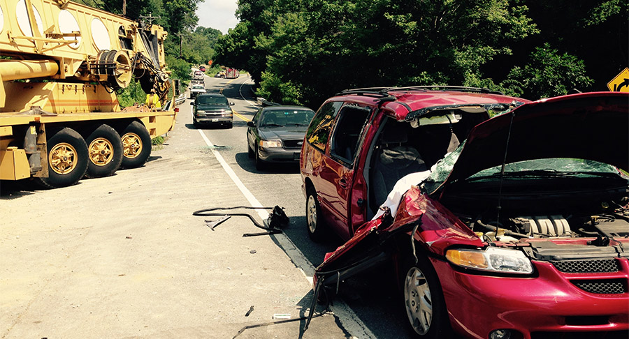 Two people were taken to Christiana Hospital after this Dodge Caravan struck parked crane along Route 7 in Red Lion. (Photo: Delaware Free News)