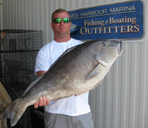 Jesse Kegley with his  record blueline tilefish. (Photo courtesy DNREC and Lewes Harbour Marina)