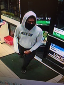 Surveillance image from 7-Eleven robbery released by Dover police