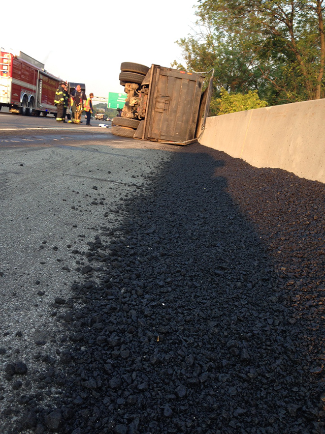 Overturned dump truck spilled its load of asphalt. (Photo: Delaware Free News)