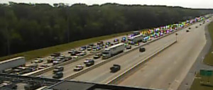 DelDOT traffic cam shows northbound backup at Dover toll plaza at 10:20 a.m.