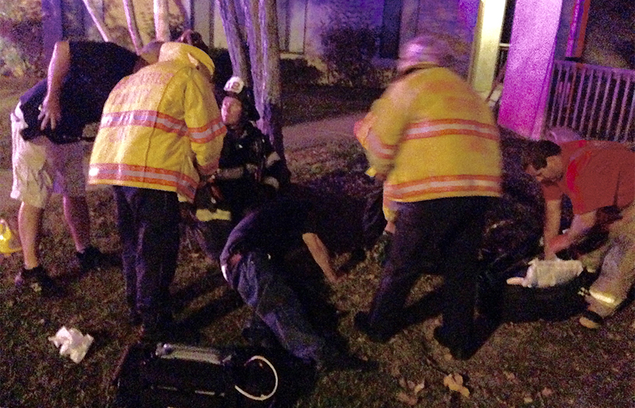 Man rescued from third-floor apartment is aided at scene on Bedford Lane. (Photo: Delaware Free News)
