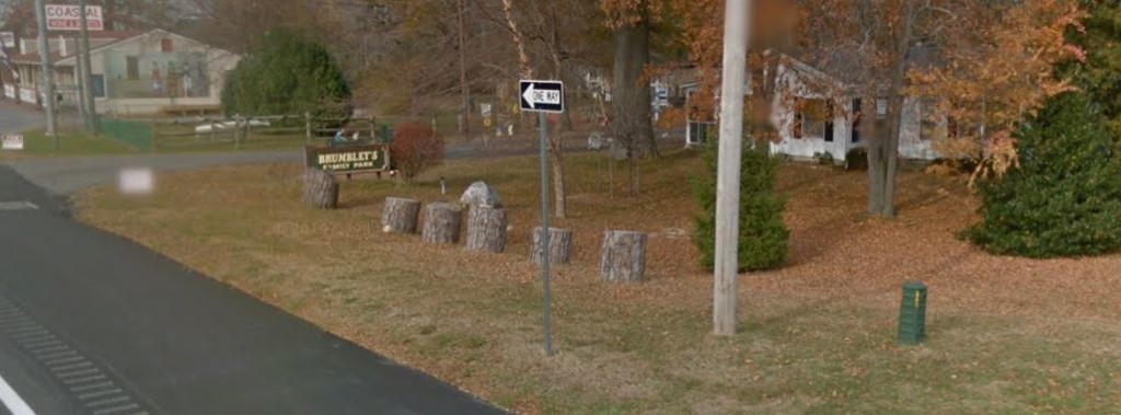 Logs and rock placed at entrance to Brumbley's Family Park on Route 1, opposite Route 5 stop sign (Photo: Google maps)