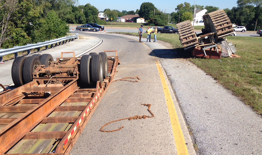 Overturned trailer (left) and overturned construction equipment it was carrying (right). (Photo: Delaware Free News)