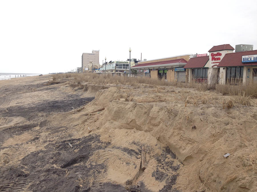 The blizzard that brought high winds and high water over the weekend eroded the dune in front of Grotto Pizza in Rehoboth Beach. (Photo: Delaware Free News)