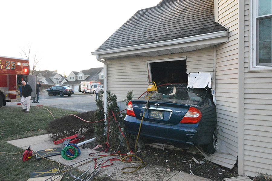 Resident was trapped between car and appliances for about 40 minutes. (Photo: Delaware Free News)