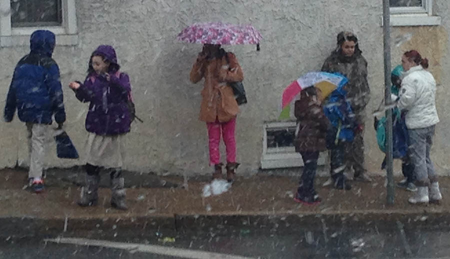 Kids wait for school bus as snow falls at Second and Franklin streets in Wilmington. (Photo: Delaware Free news)