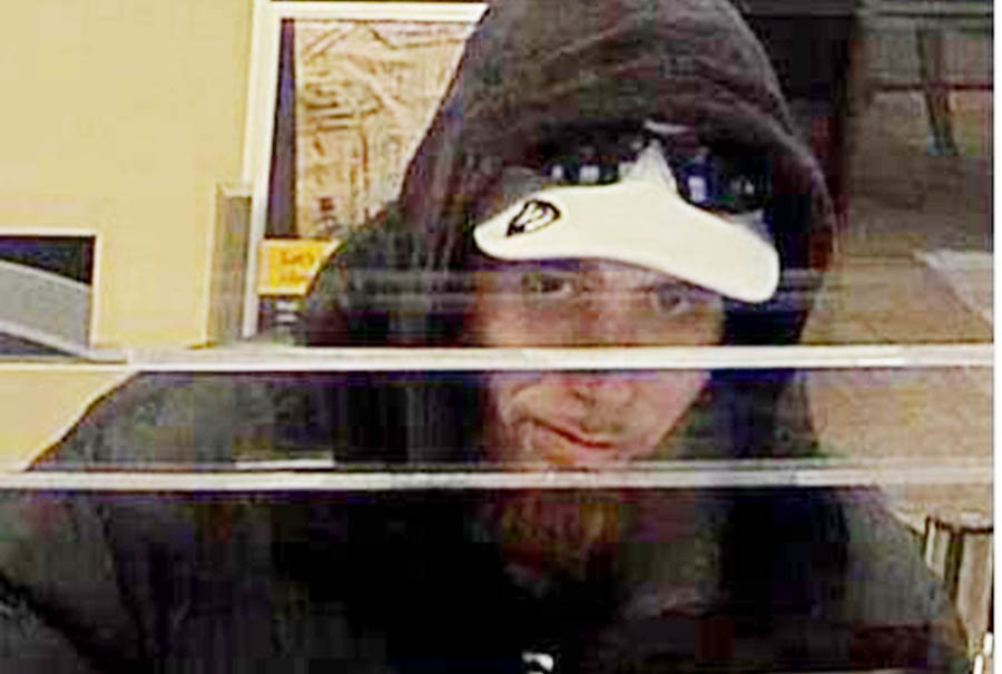 Delaware State Police released this surveillance image of man sought in robbery of WSFS bank branch in Glasgow and attempted robbery of Wells Fargo bank at the Fairfax Shopping Center on Concord Pike.
