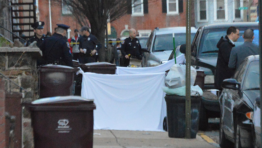 Police shielded homicide scene with sheets in the 200 block of N. Connell St. (Photo: Delaware Free News)