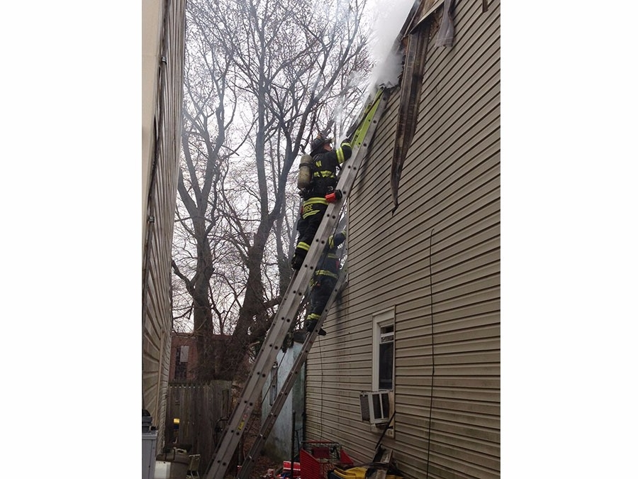 Two families were left homeless when fire heavily damaged townhomes in the 500 block of W. Ninth St. in New Castle about 10 a.m. Sunday.  Good Will Fire Company and other area firefighters responded. (Photo: Delaware Free News)