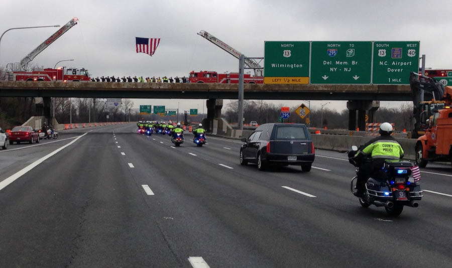 Funeral procession for Officer Jacai D. Colson moves along Interstate 95 at the Route 141 overpass near New Castle. (Photo: Delaware Free News)
