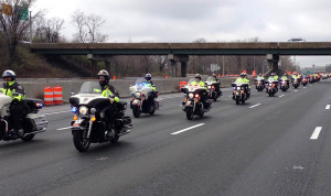 Motorcycle police officers escorted the body of Officer Jacai D. Colson on way to final resting place in Pennsylvania. (Photo: Delaware Free News)