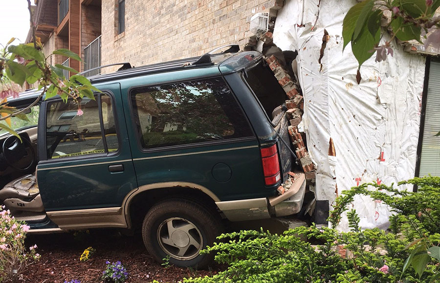 No one was injured but the building was heavily damaged about 12:30 p.m. today when an elderly woman backed an SUV into The Creeks at Marshallton Apartments. New Castle County police were on the scene and awaiting a building inspector before removing the vehicle. (Photo: Delaware Free News)