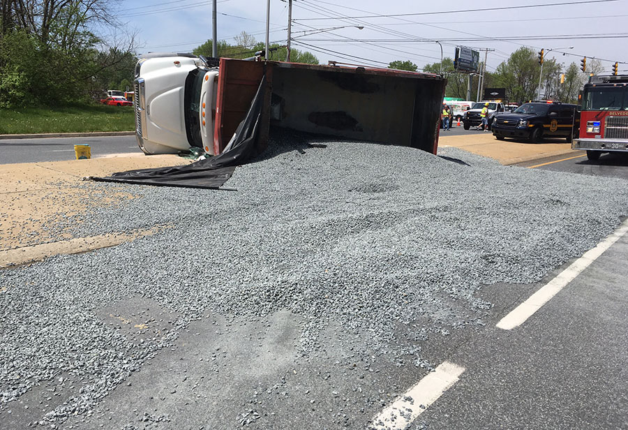 Traffic was delayed when a dump truck overturned and spilled its load of gravel shortly before noon at Salem Church Road and East Chestnut Hill Road (Route 4) in Ogletown. (Photo: Delaware Free News)
