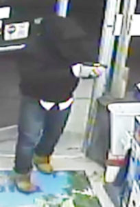 Surveillance image from Uptown Liquors robbery released by Milford police.