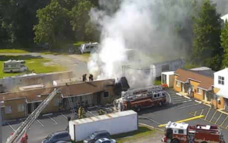 Smoke pours from Delaware Auto Court building near the 13/40 split. (Photo: DelDOT traffic cam)