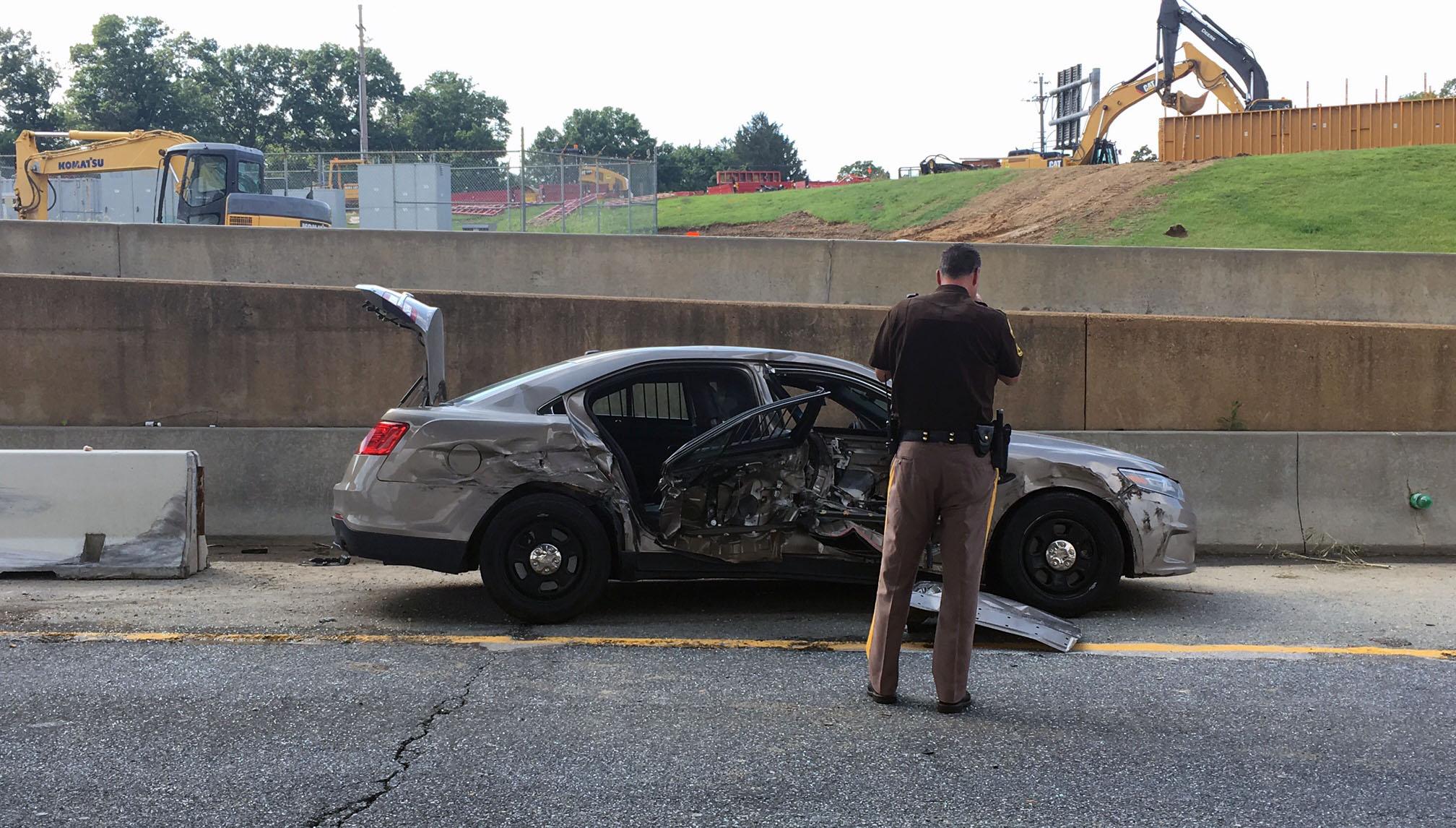 Officer, prisoner injured in police car crash with dump truck ...