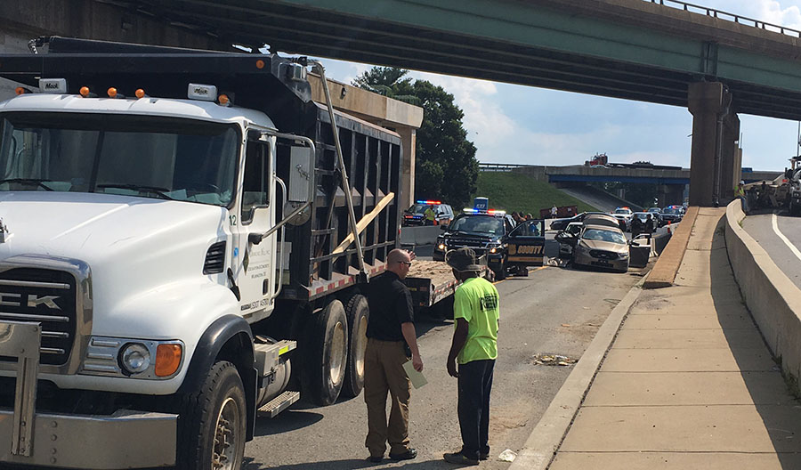 Police car and dump truck pulling trailer collided on northbound U.S. 13 beneath Interstate 295. (Photo: Delaware Free News)