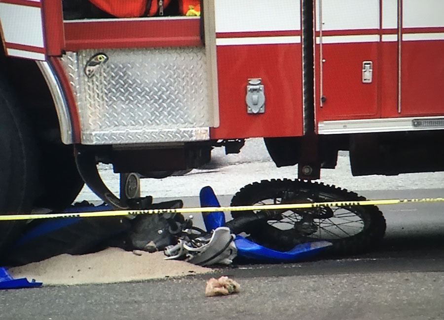 Dirt bike ended up under Wilmington Fire Department ladder truck. (Photo: Delaware Free News)