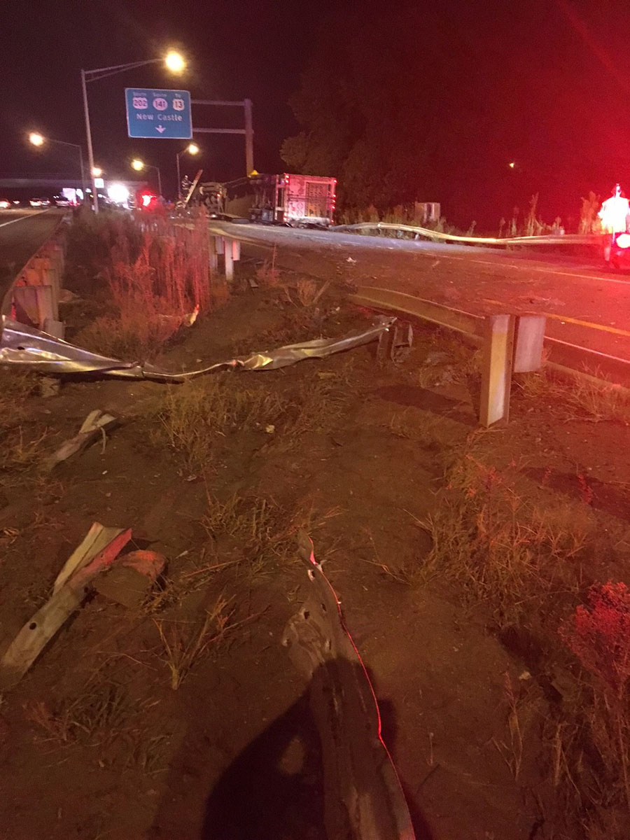 Tractor-trailer took out guard rail on I-95 before overturning. (Photo: Delaware Free News)