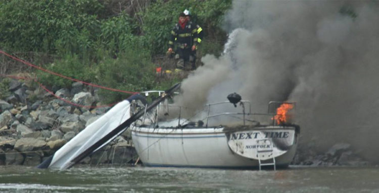 """Sailboat """"Next Time"""" burns on the Chesapeake & Delaware Canal. (Photo: Delaware City Fire Company)"""