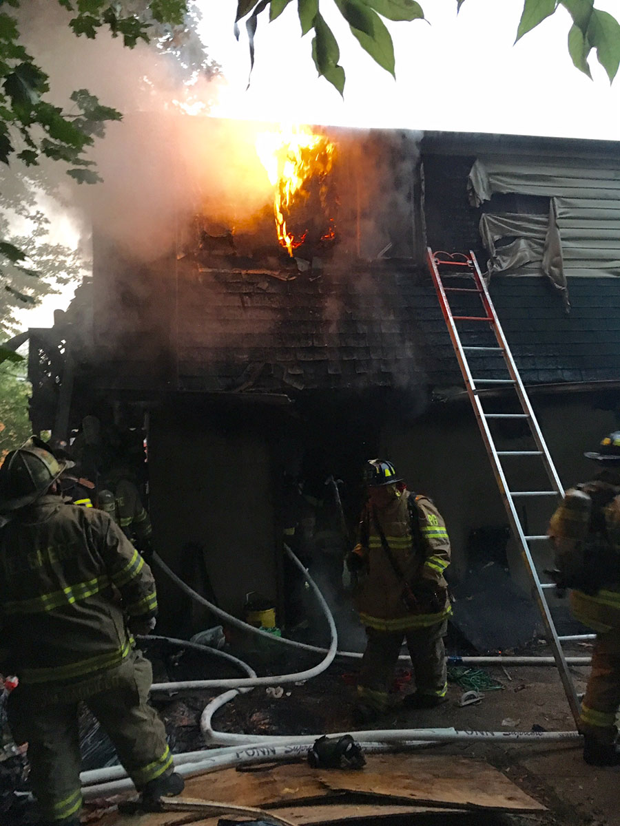 Fire broke out in apartments over garage at 2 State St. in Tuxedo Park neighborhood west of Newport. (Photo: Delaware Free News)
