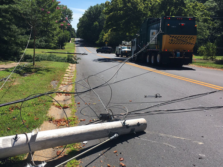 Waste Management truck brought down poles and wires along Sharpley Road in Talleyville. (Photo: Delaware Free News)