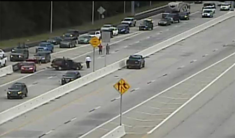 Crash scene at Dover toll booth on northbound Route 1. (Photo: DelDOT traffic cam)