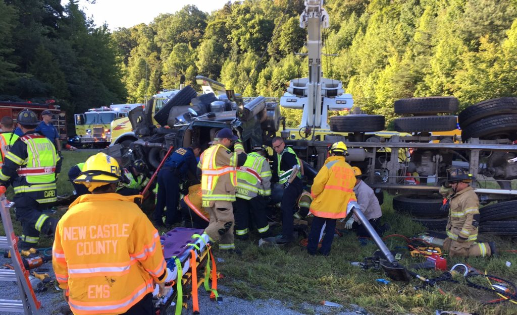 Aetna Hose, Hook & Ladder Company firefighters extricate dump truck driver. (Photo: Delaware Free News)