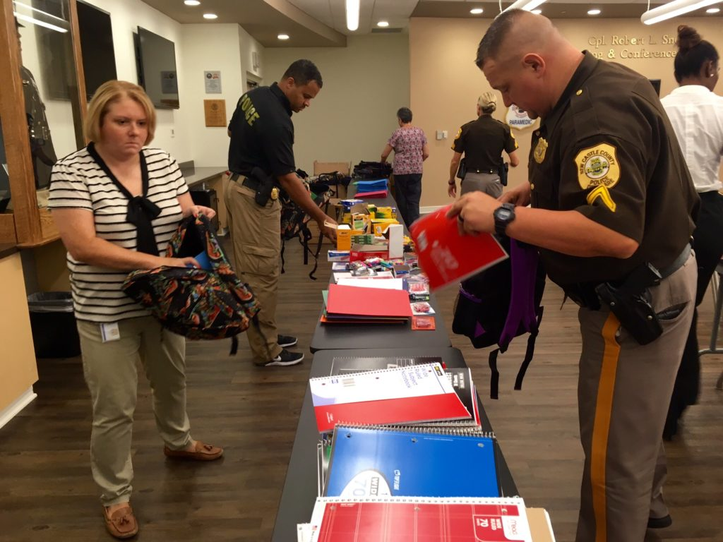 New Castle County police pack school supplies. (Photo: Delaware Free News)