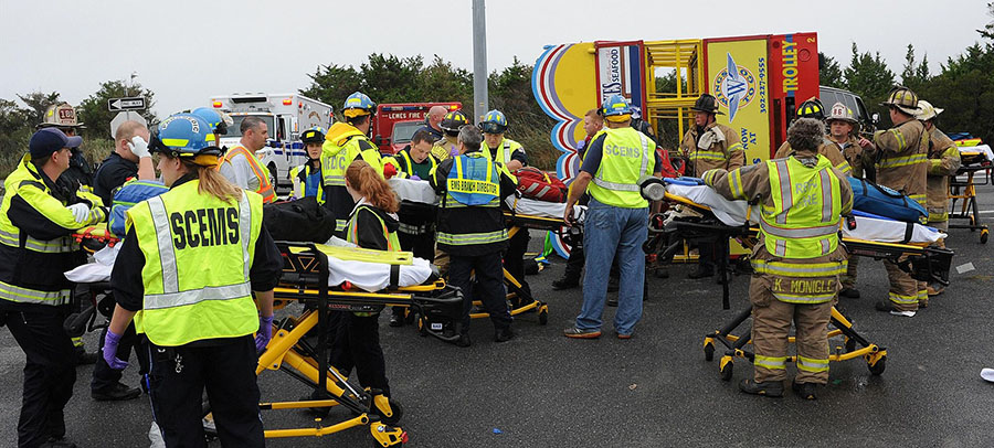 Emergency workers treat injured at Jolly Trolley crash scene. (Photo: Rehoboth Beach Volunteer Fire Company)