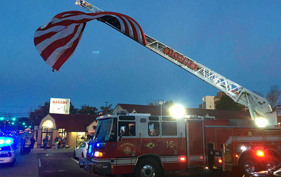 Serpe and Sons Bakery at 1411 Kirkwood Highway in Elsmere reopened with an Elsmere Fire Company ladder truck raising the flag. (Photo: Delaware Free News)