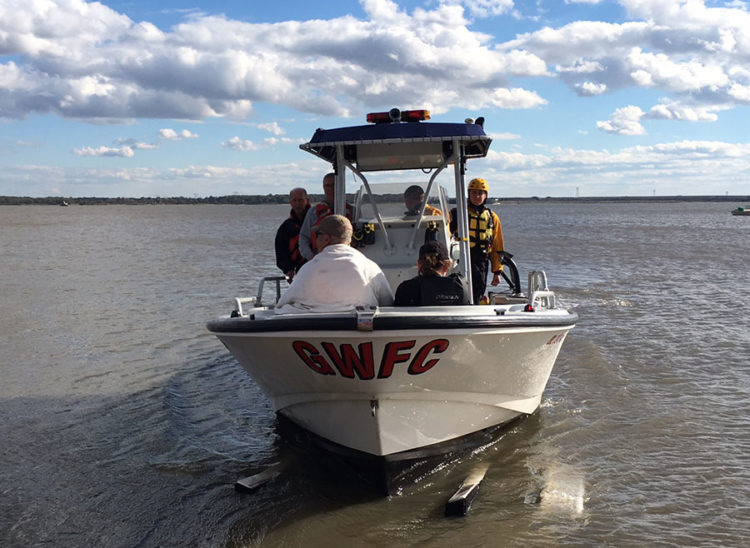 Couple was returned to shore on Good Will Fire Company boat after their sailboat overturned in Delaware River. (Photo: Delaware Free News)