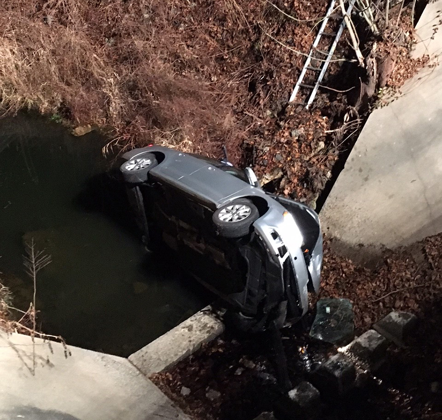 Hockessin and Avondale firefighters extricated driver from car that crashed into spillway at Somerset Lake. (Photo: Delaware Free News)