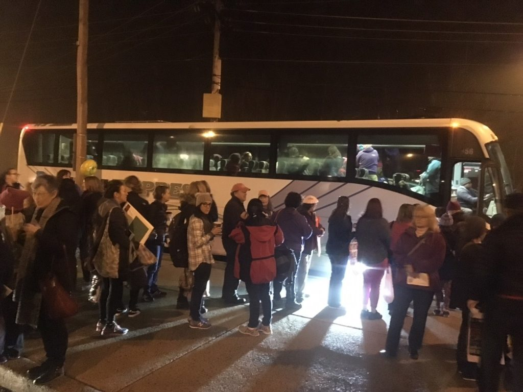People heading to the Women's March on Washington board buses at park-and-ride lot near Routes 273 and 7. (Photo: Delaware Free News)