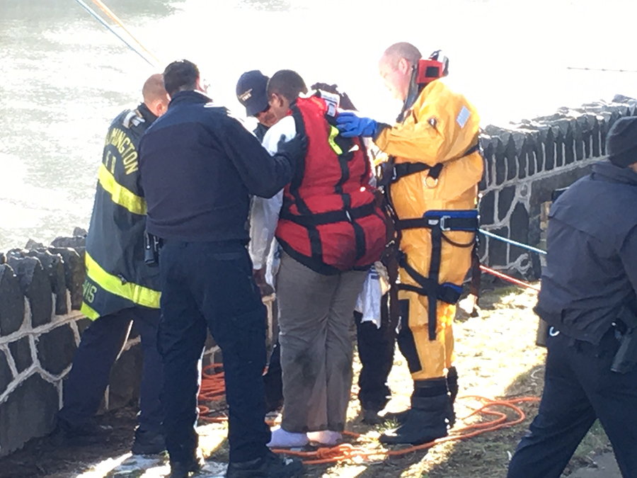 Teenager is rescued from drainage tube by Wilmington firefighter. (Photo: Delaware Free News)
