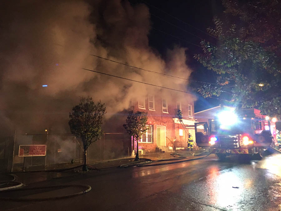 Wilmington firefighters battled blaze in three-story building at Fifth and Dupont streets about 8 p.m. Tuesday. (Photo: Delaware Free News)