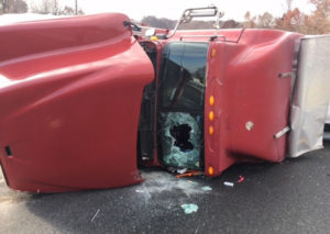 Tractor-trailer carrying produce overturned on ramp from northbound Route 896 onto northbound Interstate 95. (Photo: Delaware Free News)